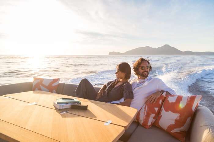 yacht charter vacation: couple relaxing
